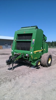 Detail photo of 2011 John Deere 568 from Construction Equipment Guide