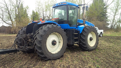 Detail photo of 2006 New Holland TJ330 from Construction Equipment Guide