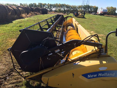 Detail photo of 2009 New Holland 72C-30 from Construction Equipment Guide
