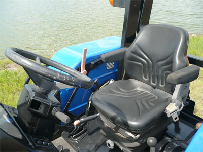 Detail photo of 2003 New Holland TL80 from Construction Equipment Guide